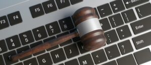 Cyber crime concept. Law gavel on computer keyboard, banner. Top view, 3d illustration
